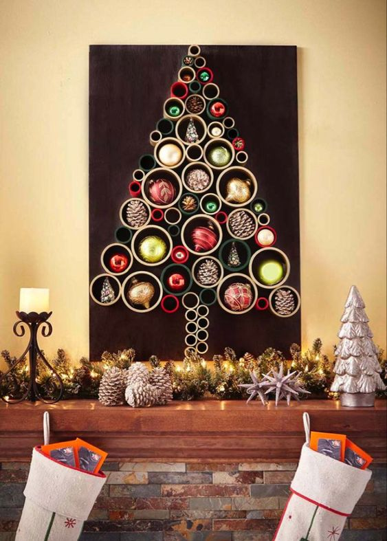 a colorful Christmas tree of PVC pipes and bright ornaments and pinecones inserted into them for decor
