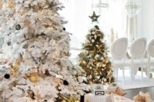 15 a flocked Christmas tree with black and gold ornaments and a usual one wtih black and white ornaments