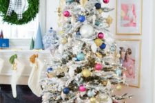 16 a flocked Christmas tree with colorful ornaments and lights plus a star topper for a fun touch