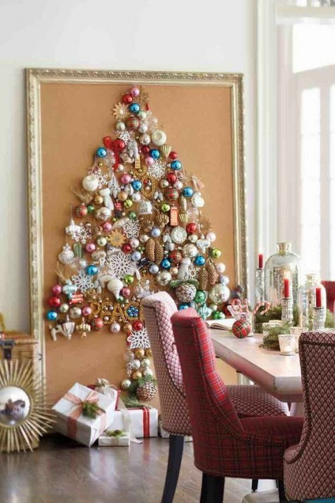 a large Christmas tree art shaped of ornaments of various kinds and brooches is super glam and whimsy