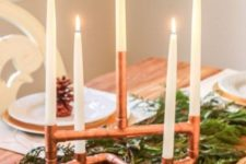 17 a gorgeous copper piping candelabra will easily become a cool Christmas decoration, place it on evergreens for a chic look