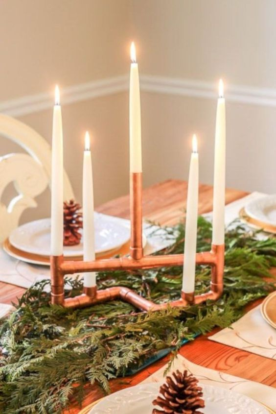 a gorgeous copper piping candelabra will easily become a cool Christmas decoration, place it on evergreens for a chic look