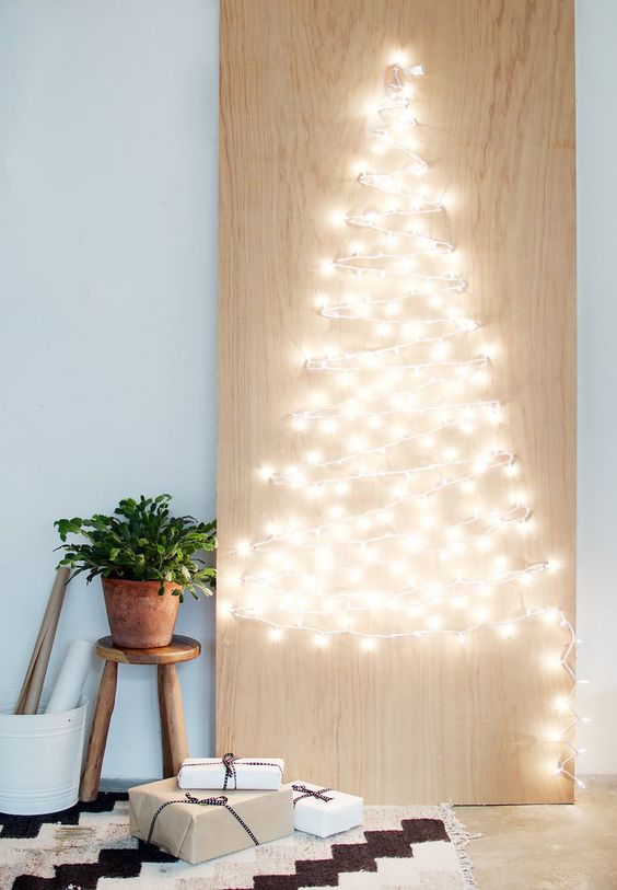 a string light Christmas tree is a creative and festive idea that you can easily DIY