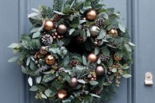 19 beautiful copper and chocolate Christmas ornaments, frosted pine cones and miniature copper bells will make your wreath super elegant