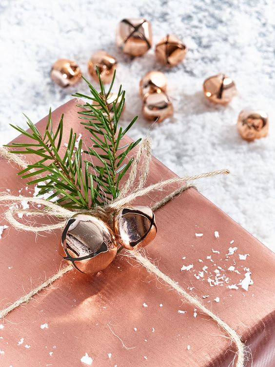 copper gift wrapping and bells and evergreen sprigs will make your Christmas gifts super special and desired