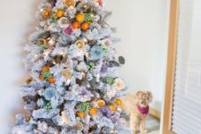 22 a whimsical flocked Christmas tree decorated with flowers and citrus and citrus slices plus lights