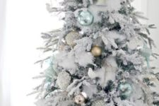 24 light green and matte gold ornaments look very fresh on a flocked Christmas tree and feel very natural and cool