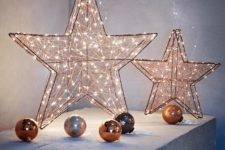 24 lit up copper stars and ornaments are perfect to make your Christmas decor warming up and very bright