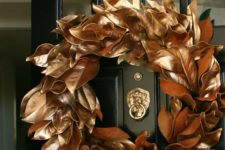 25 make a magnolia leaf wreath and spray paint it with copper to give it a chic metallic look and a refined touch