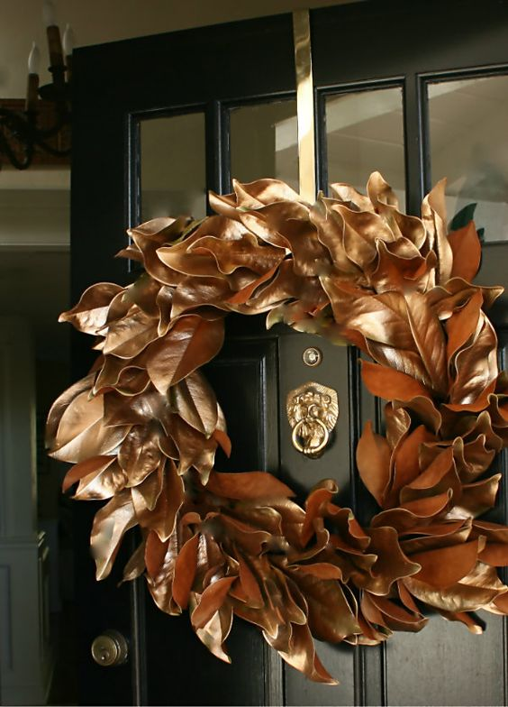 make a magnolia leaf wreath and spray paint it with copper to give it a chic metallic look and a refined touch