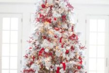 25 red and white Christmas tree decor with ornaments and striped and brigth ribbons is a bold solution and looks rather traditional