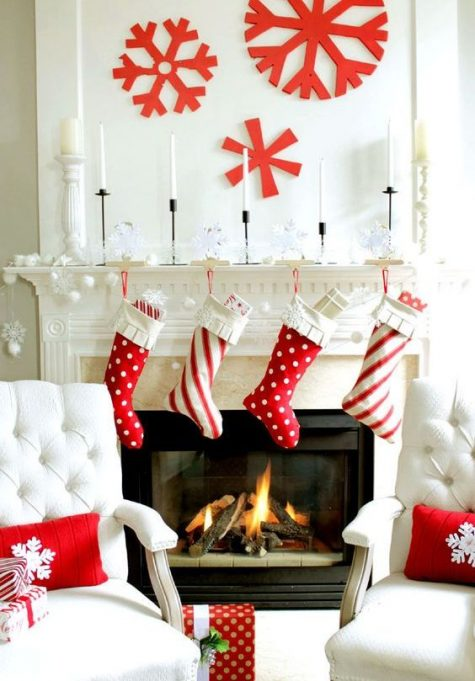 red and white stockings, large red snowflakes on the wall for fun and cool Christmas decor
