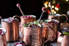 26 serve holiday drinks in hammered copper mugs to add a cozy and cute touch to the tablescape