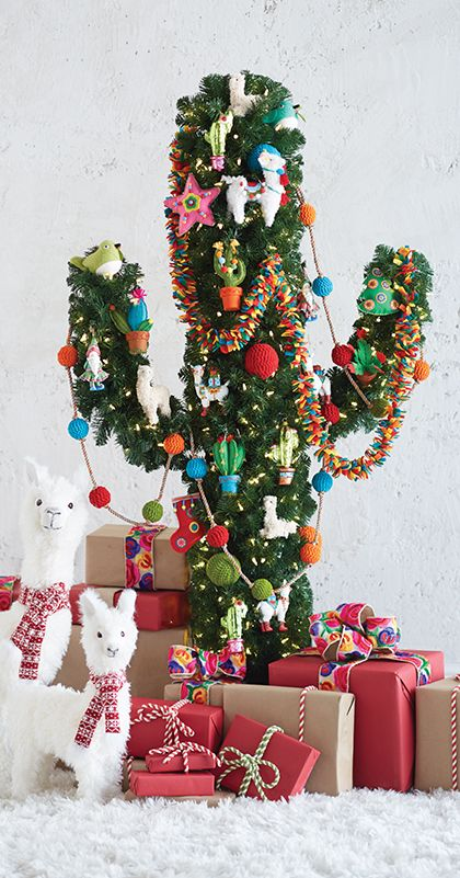 a cactus Christmas tree with colorful ornaments, garlands and lights and little alpaca figurines