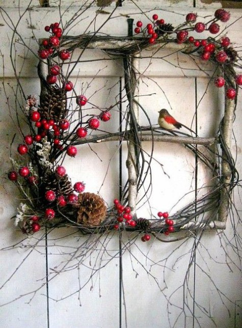 a Christmas decoration instead of a usual wreath   a brnch frame with twigs, berries, moss and pinecones