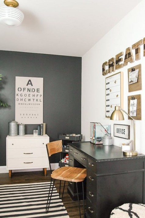 a farmhouse industrial home office with a metal desk, a hairpin leg chair, some plywood decor and a striped rug