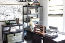 a modern meets industrial home office with metal lamps and chandeliers, metal shelving units, a woodden desk and a jute rug
