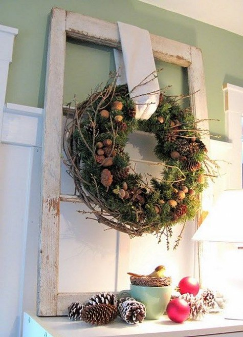 a natural Christmas wreath of greenery, pinecones, nuts, acorns and twigs is a cool decoration for a rustic space