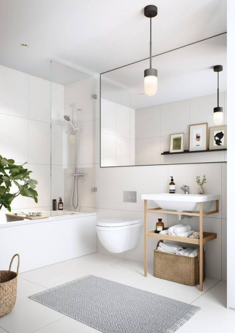 a neutral contemporary bathroom with large scale tiles, an oversized mirror and a wooden vanity