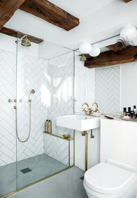 a pure white bathroom spruced up with dark wooden beams and gold touches that make it eye-catchy