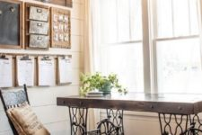 a rustic meets industrial home office with a desk made of a vintage sewing machine, a wooden note board, a vintage wooden chair