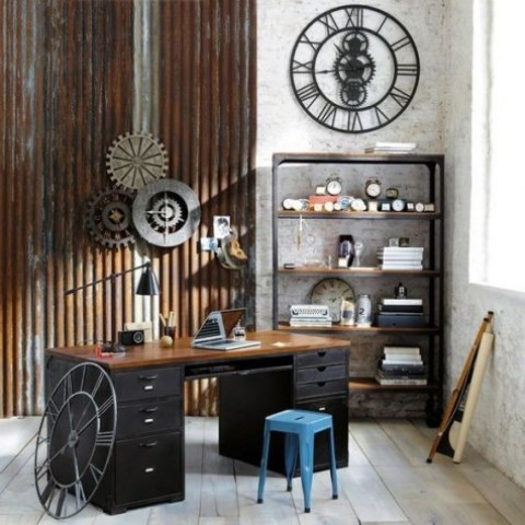 an industrial home office with a wooden desk, metal pipes on the wall, metal wheels, a shelving unit of wood and metal