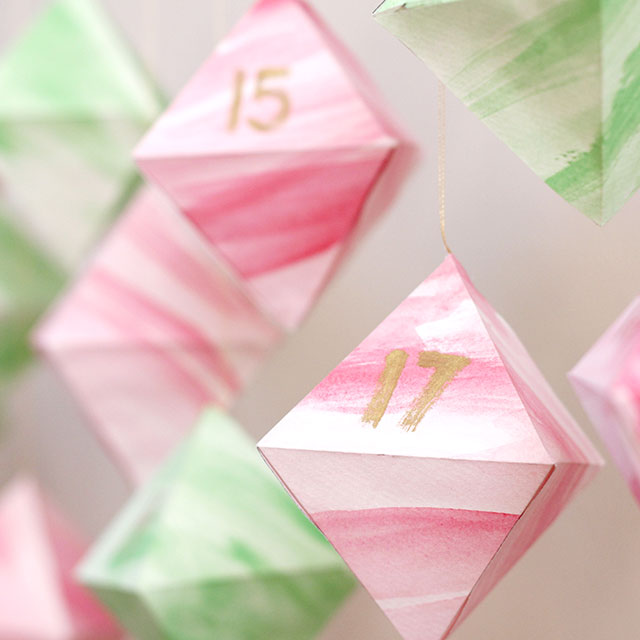 DIY watercolor rhomb advent calendar or ornament (via www.wecanmakeanything.net)