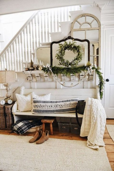 cozy knit pillows and a blanket, an evergreen garland and wreath will create a Christmas feel