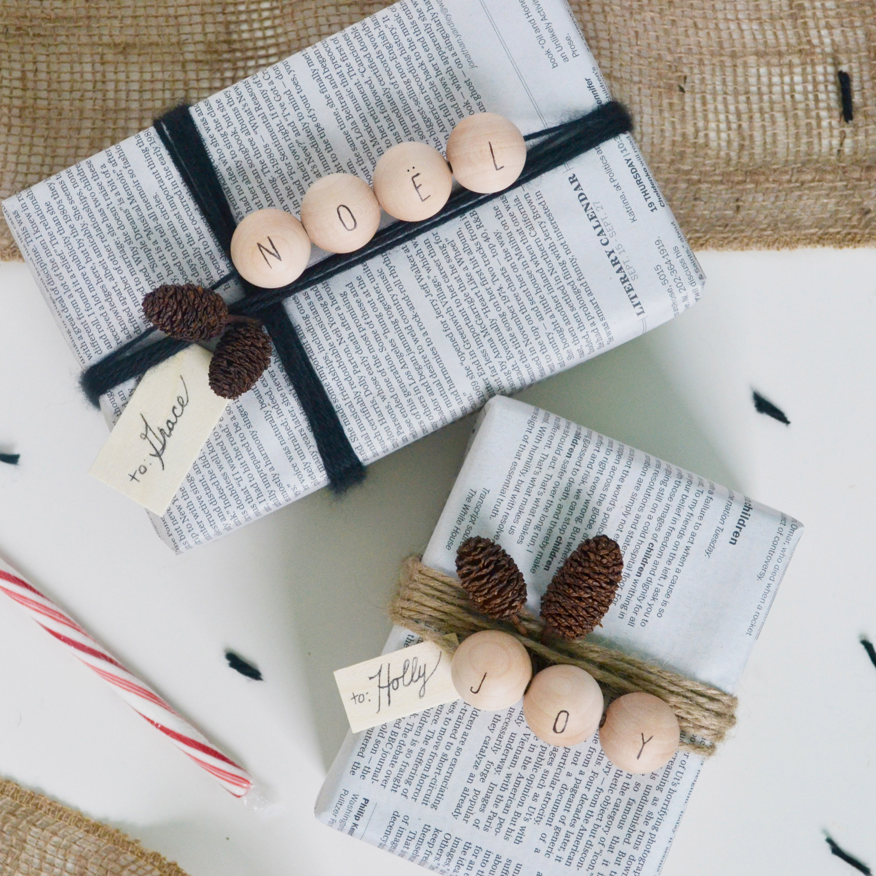 DIY holiday gift wrap with pinecones and wooden beads