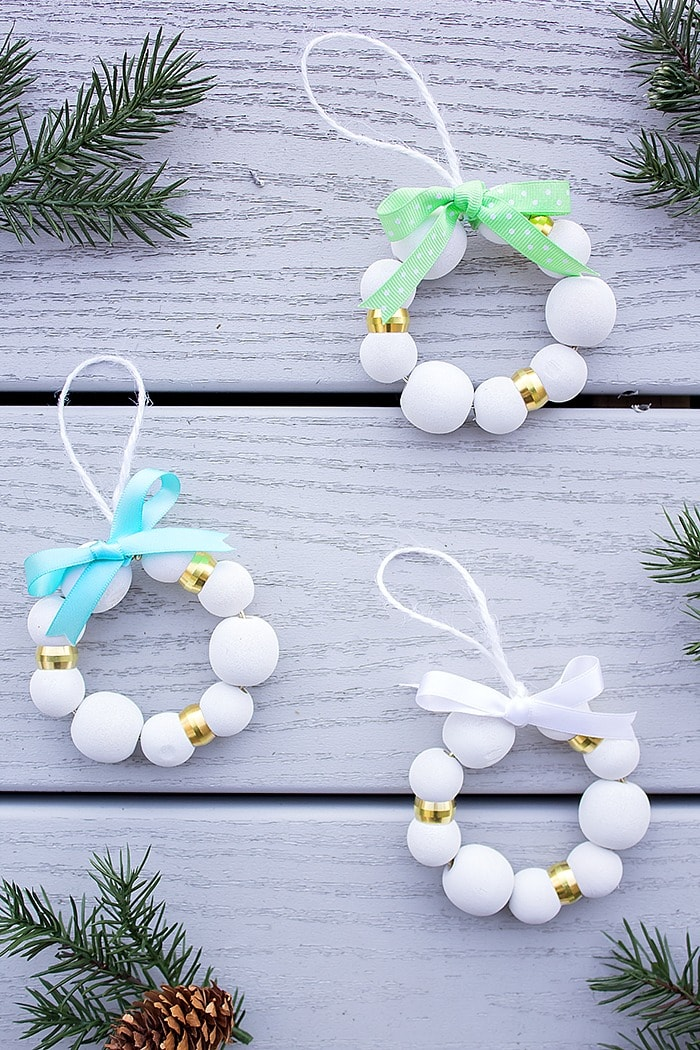 DIY wooden bead Christmas wreath ornament with bows (via aprettyfix.com)
