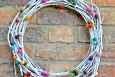 DiY whitewashed vine wreath with colorful felt balls for Christmas and not only