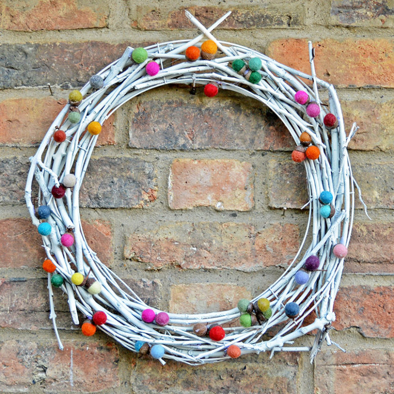 DiY whitewashed vine wreath with colorful felt balls for Christmas and not only (via www.pillarboxblue.com)