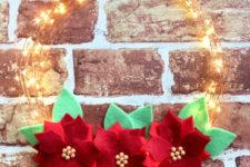 DIY fairy light Christmas wreath with felt blooms