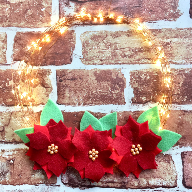 DIY fairy light Christmas wreath with felt blooms