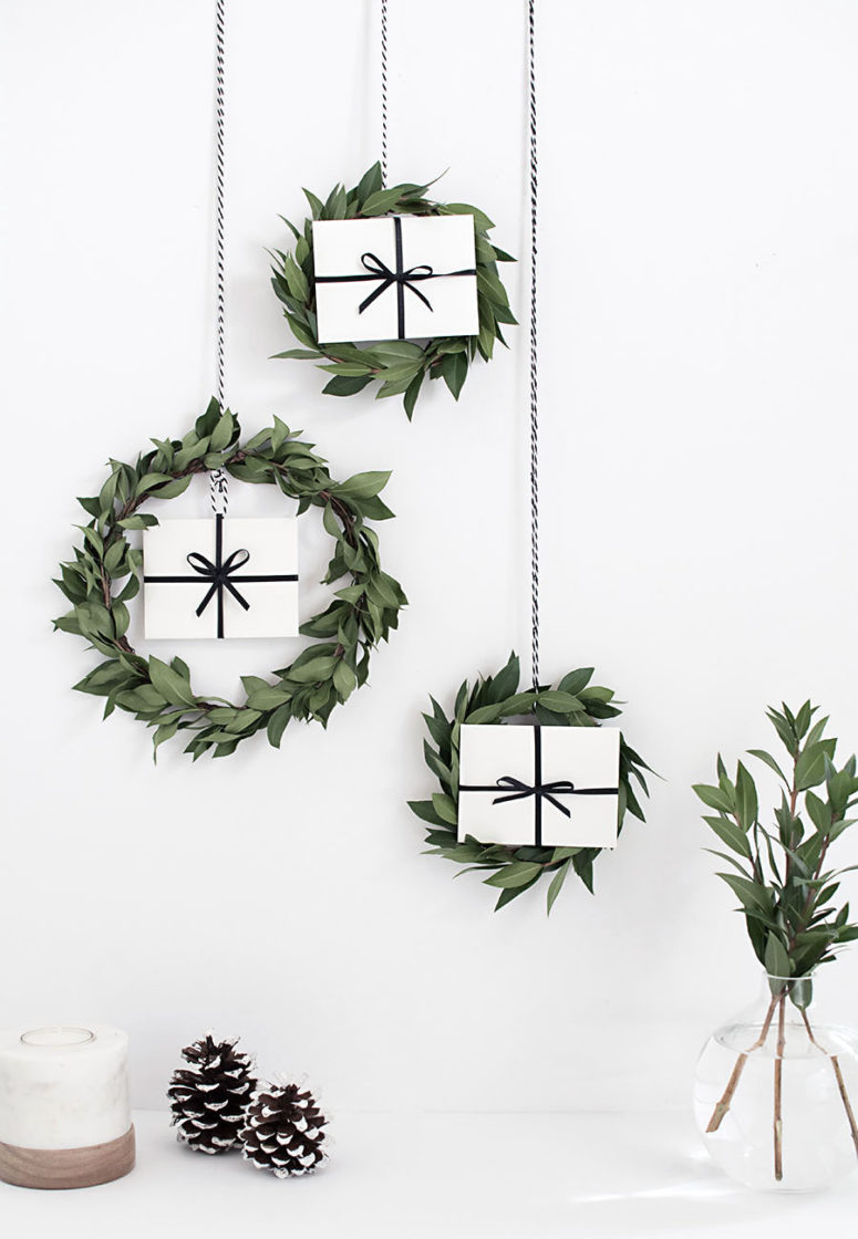 DIY myrtle Christmas wreaths with gift boxes inside (via www.homeyohmy.com)