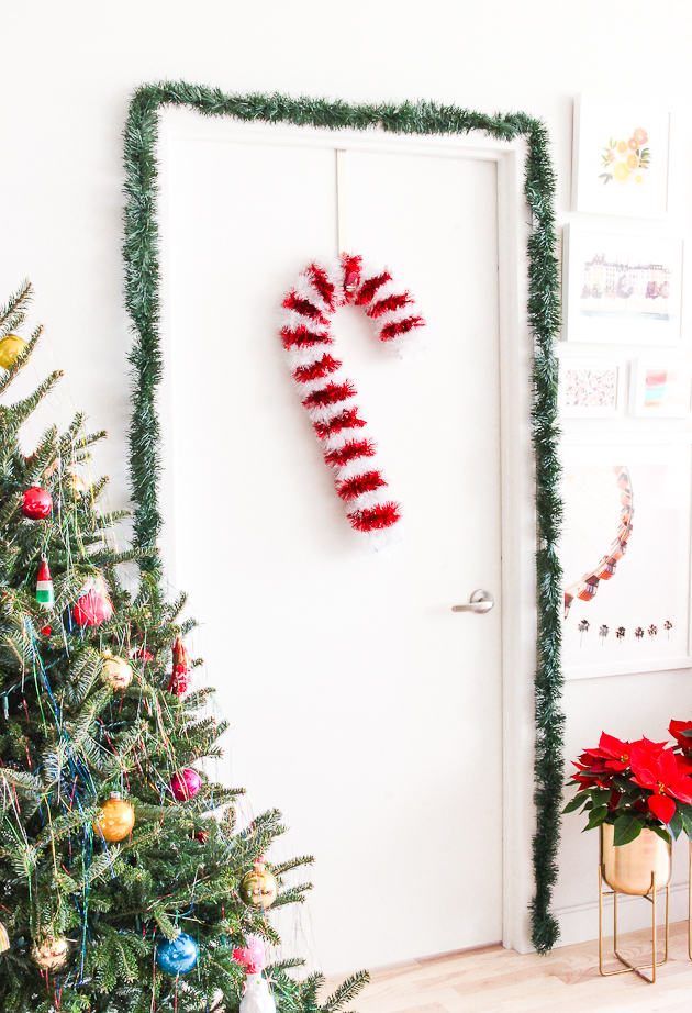 DIY candy cane tinsel wreath for Christmas front door decor (via thecraftedlife.com)