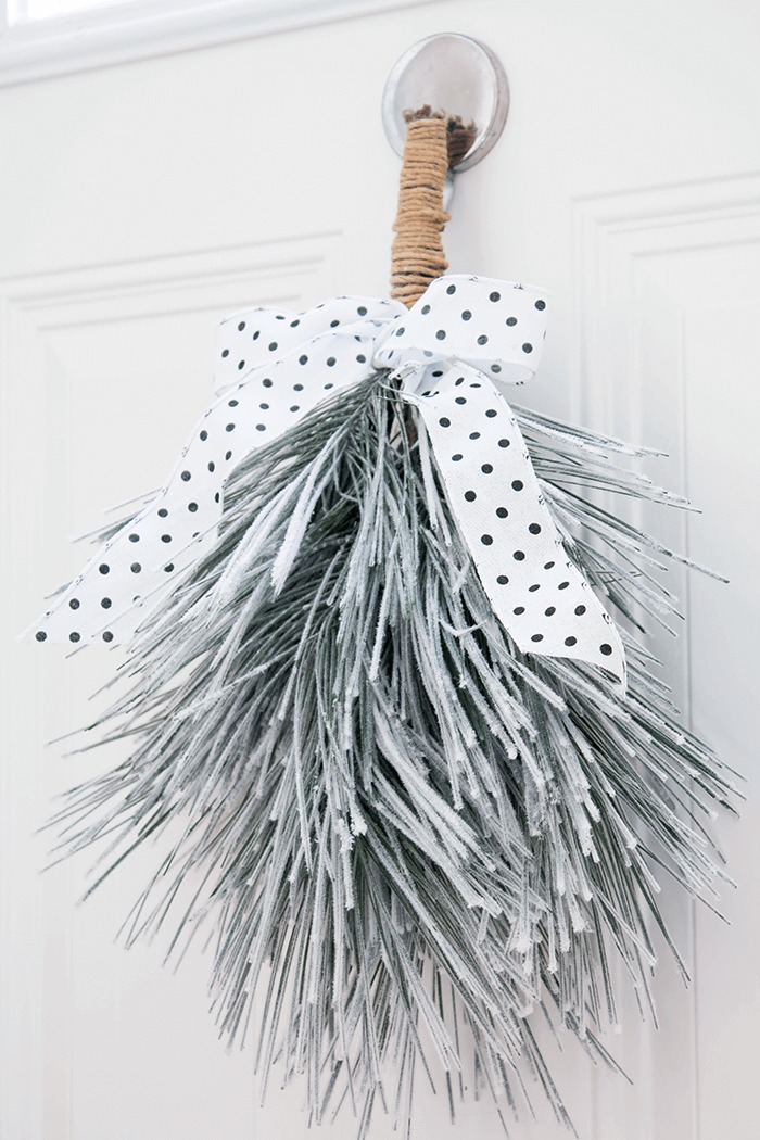 DIY simple and modern winter swag Christmas front door decoration (via aprettyfix.com)