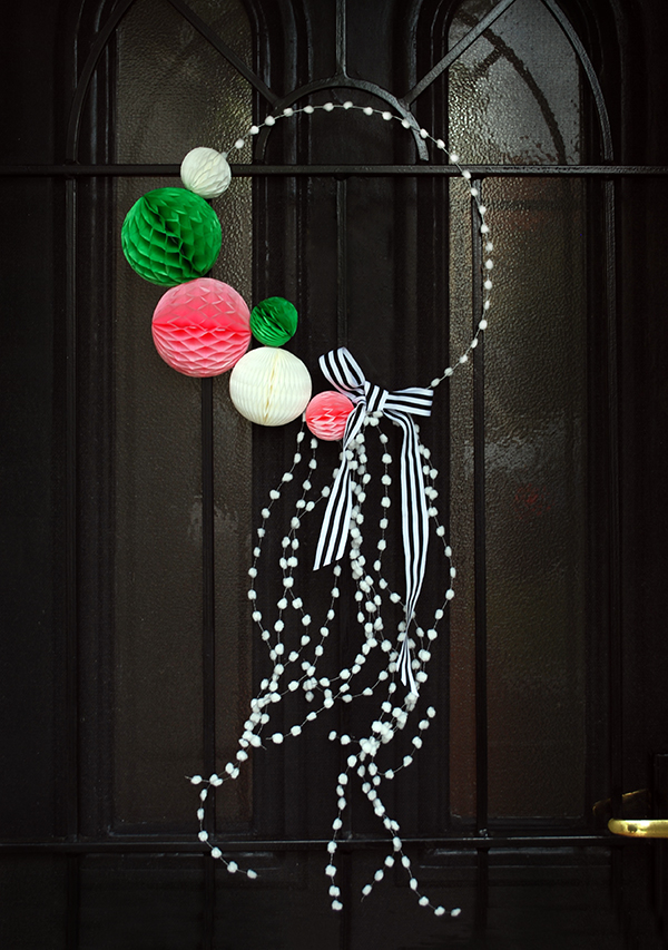 DIY playful red, green and white Christmas wreath with pompoms (via www.we-are-scout.com)