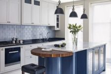 02 a blue kitchen island with white cabinets and different countertops – black for cabinets and a white stone one for the island