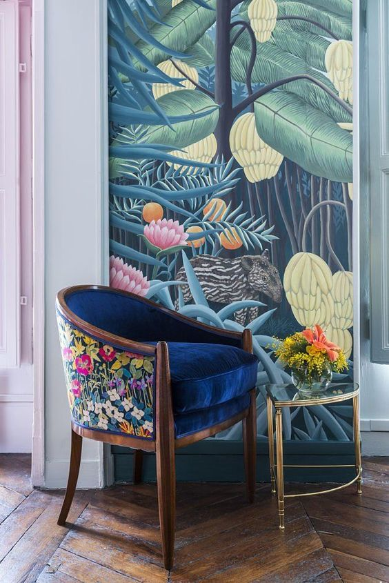 a bold and refined chair with a deep blue seat and floral back with bold patterns will add chic and texture to your room
