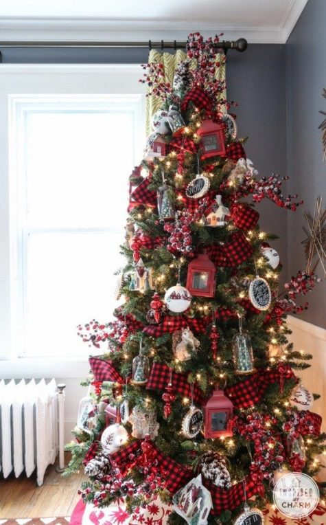 a bright vintage Christmas tree in red, white and black, with plaid ribbons, berries and lights