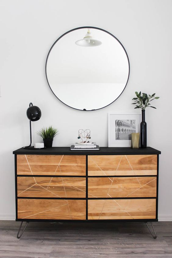 a contemporary Tarva hack with black paint, light-colored stain, a geometric pattern and hairpin legs