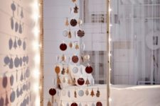 02 a frame Christmas tree of an IKEA Ivar side unit, IKEA light chain and some ornaments of your choice and you have an alternative Christmas tree