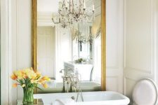 a bathroom with a statement chandelier