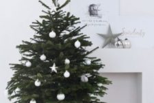 03 a minimalist Christmas tree in a basket with white ornaments is a stylish and cool idea with a rustic feel