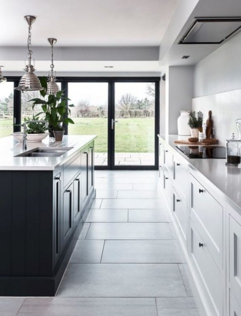 black and white is classics, a black kitchen island is great to spruce up a white space, add black knobs to the cabinets