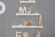 04 IKEA RIBBA picture ledges used to make a wall-mounted Christmas tree is a creative and fun idea