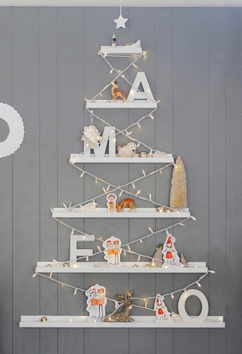 IKEA RIBBA picture ledges used to make a wall-mounted Christmas tree is a creative and fun idea