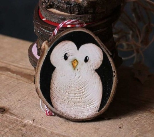 a cute wood slice penguin ornament can be DIYed for Christmas easily, by you or by your kids