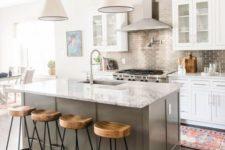 04 a white kitchen with a grey kitchen island, a stone countertop and a metallic tile backsplash